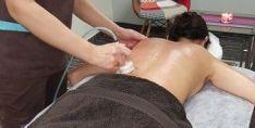 Vakuuminis nugaros masažas su karštais akmenimis