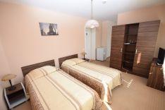 Verslo klasės kambarys su atskiromis lovomis