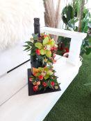 Butelio dekoras gyvomis gėlėmis